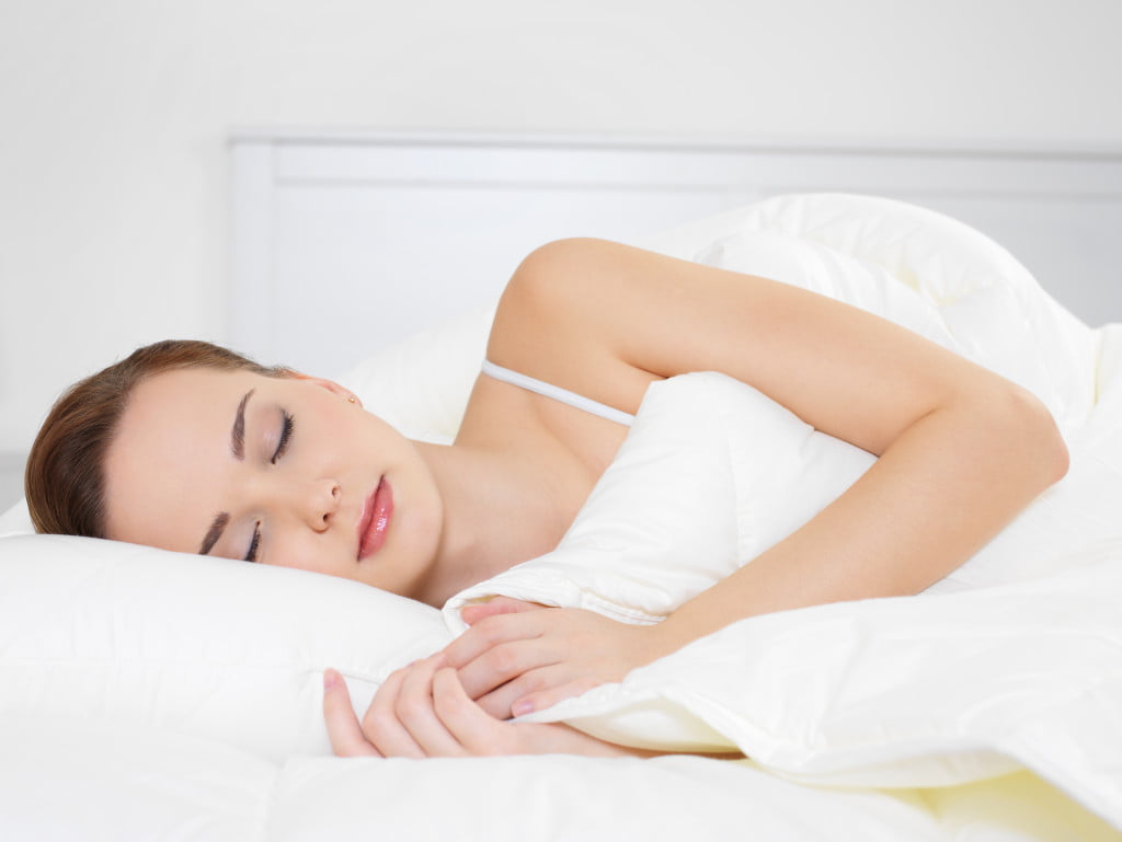Young woman sleeping on side